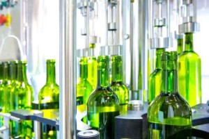 White wine in bottling machine at winery.